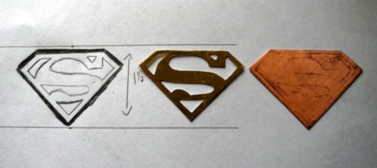 Superman S from sketch to metal